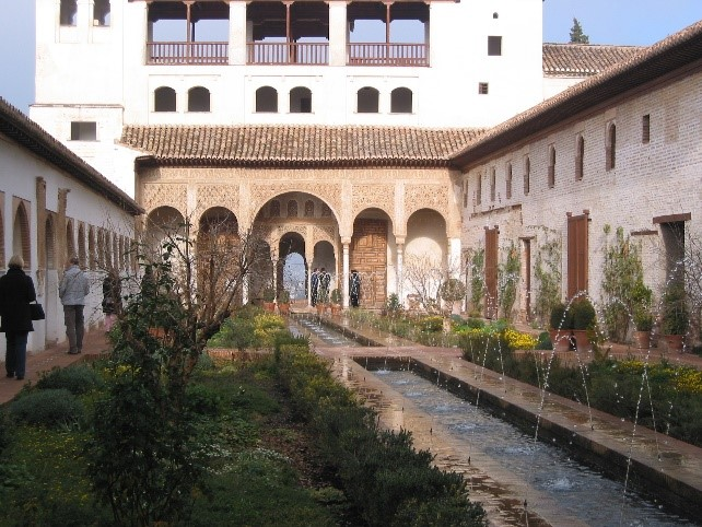 Photo 15. Water channel with fountains and buildings in the Generalife.