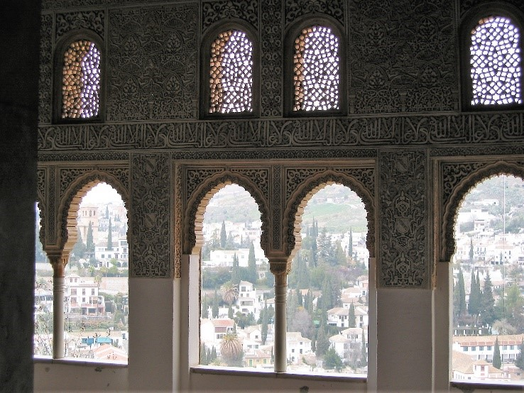 Photo 5. The intricate plasterwork of the walls and a view across part of Granada  city from the Mexaur.