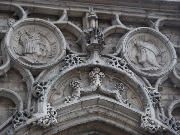 Photo 3. The bas reliefs of Maximilian and Mary, and Philip the Handsome on the Stadhuis.