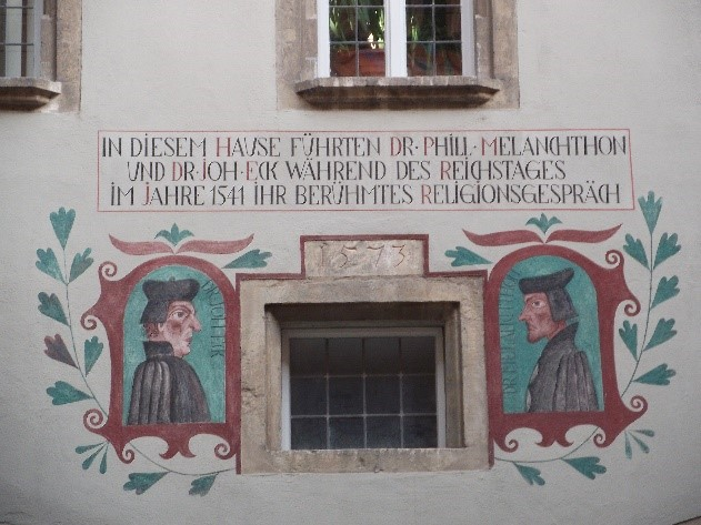 The modern fresco commemorating the 1541 meeting of Dr Joannes Eck and Philip Melanchthon, who were brought together by Charles V in an effort to achieve reconciliation between Catholics and Protestants.