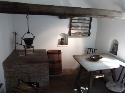 A bedroom and kitchen in a house in the Fuggerei
