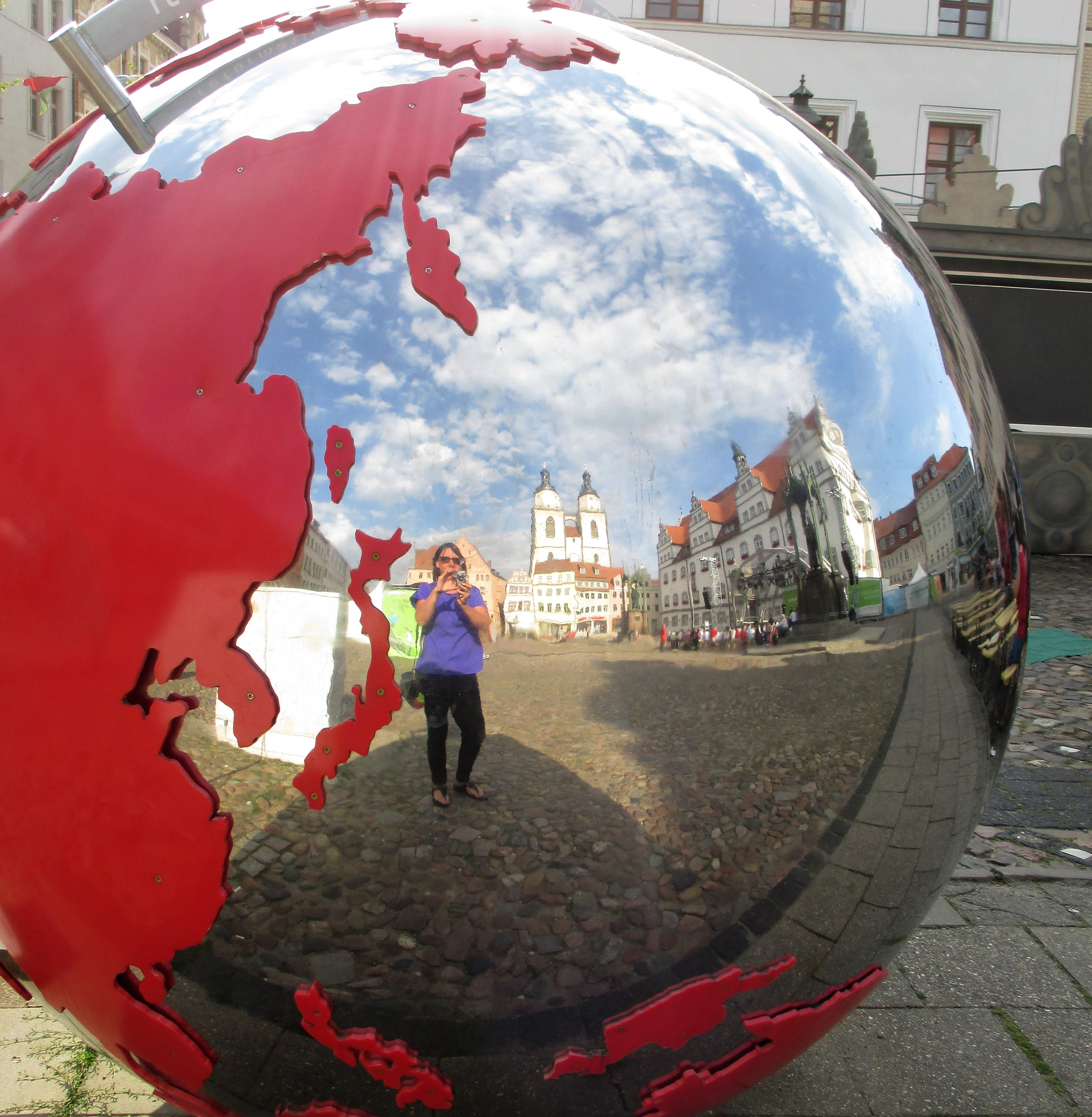 In the Marktplatz, with reflections of the Rathaus and St. Mary's Church.