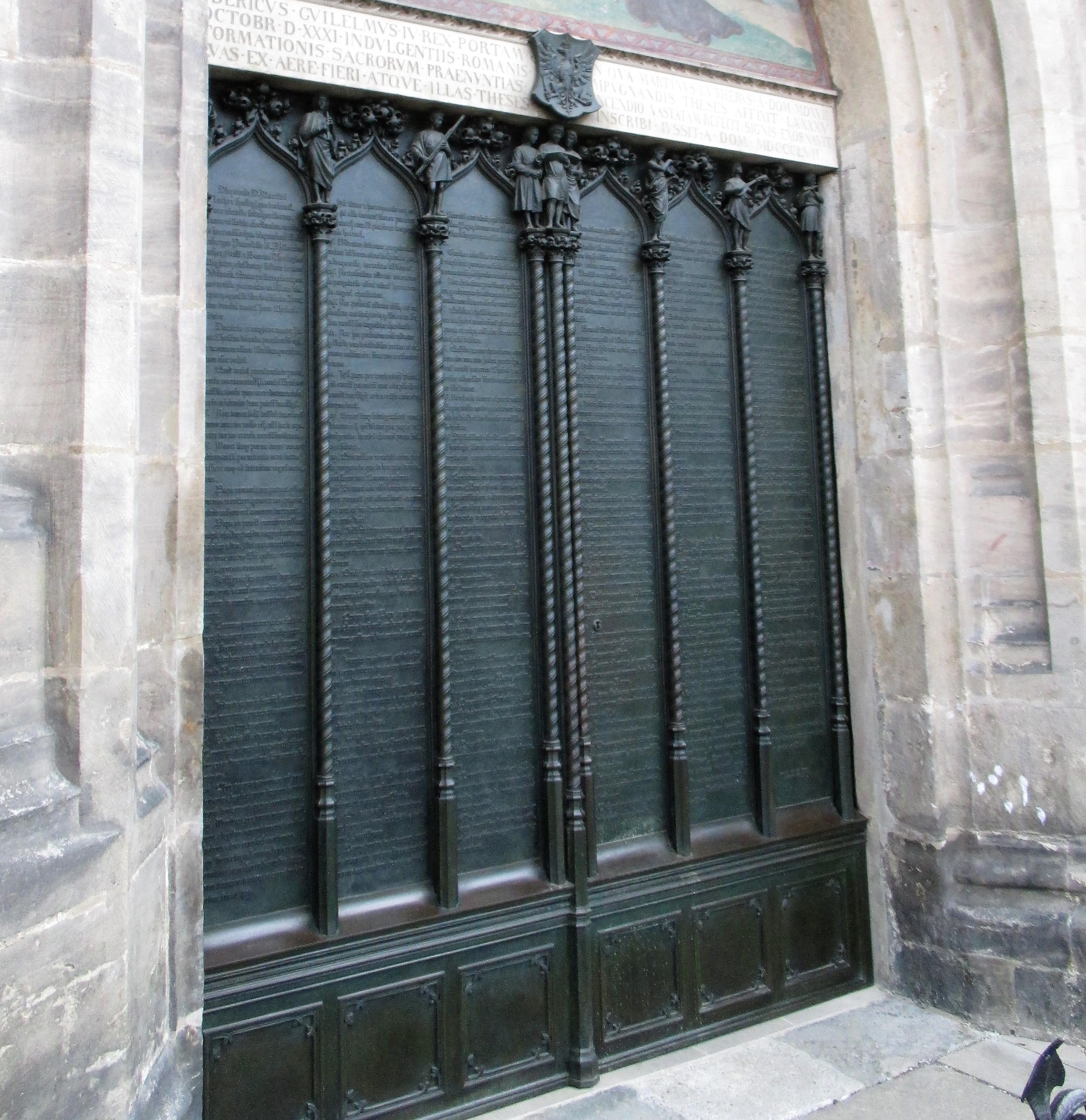 The bronze doors of the Schosskirche.